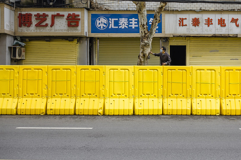 A man stands on a platform while waiting for a delivery in Wuhan, Hubei province, March 22, 2020. Gerry Yin/Wild Photos