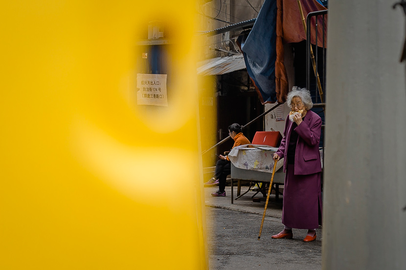 A woman enjoys a snack in Wuhan, Hubei province, March 22, 2020. Gerry Yin/Wild Photos