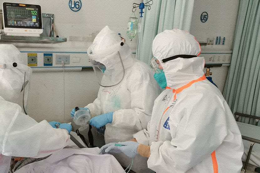 Medical workers treat a patient at Hankou Hospital in Wuhan, Hubei province, Feb. 23, 2020. The personal protective equipment available has improved significantly since late January. Courtesy of Wu Feng