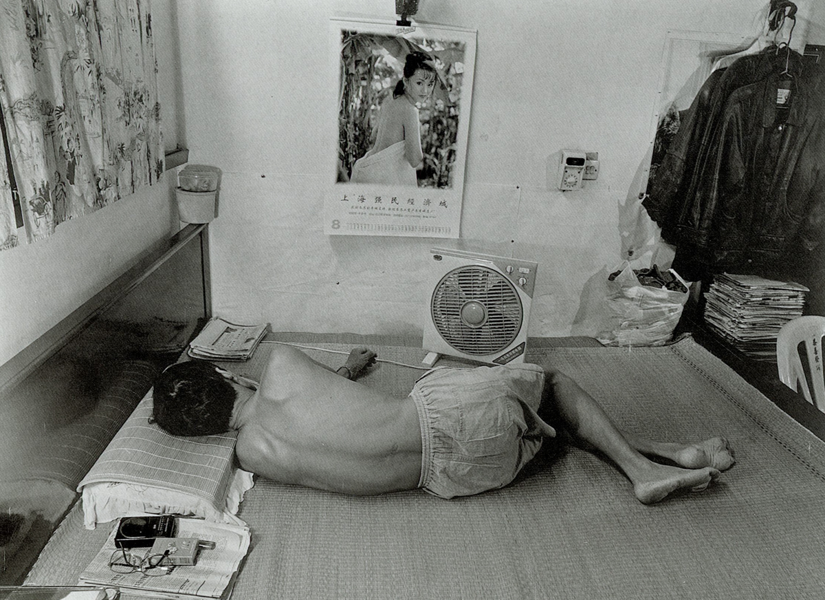 A man naps on a hot day on Dongning Road, Shanghai, 1998. Courtesy of Wu Jianping