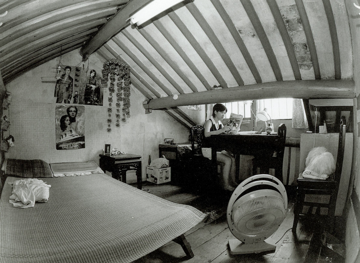 A nursing student studies in her loft at home on Dongchang Road, Shanghai, 1998. Courtesy of Wu Jianping