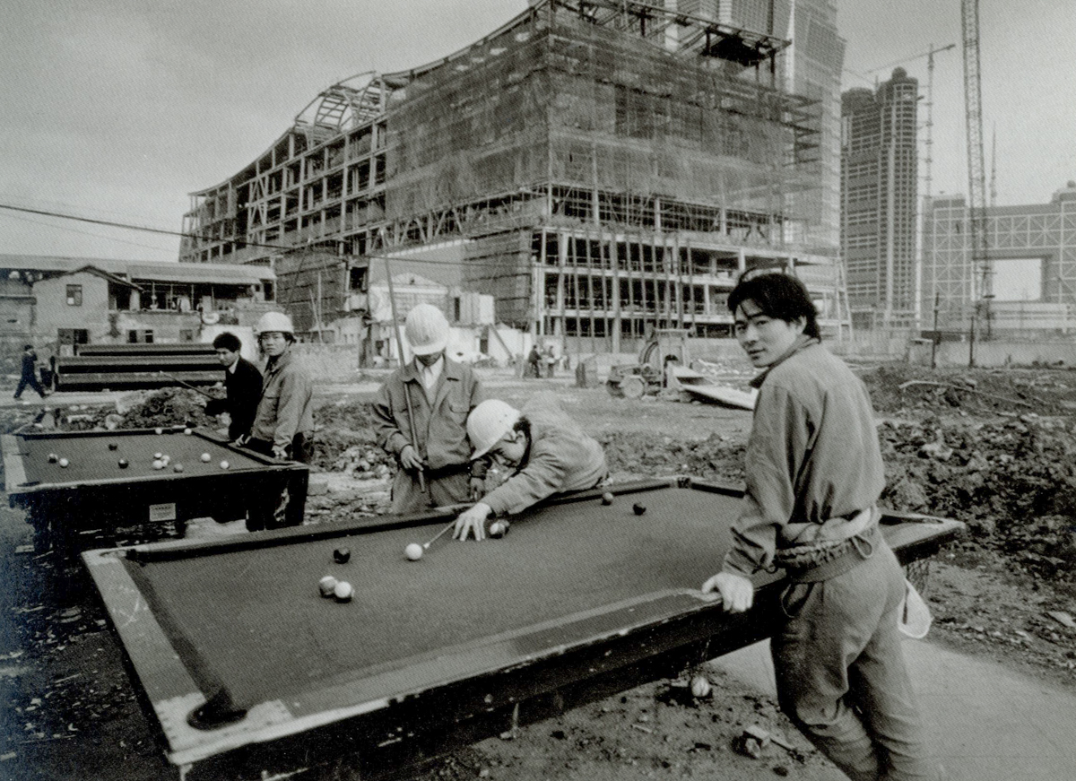 Workers play pool at a construction site on Huayuanshiqiao Road, 1997. Courtesy of Wu Jianping