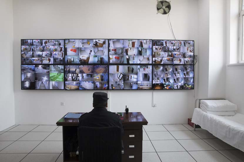 A security guard monitors the 24-hour surveillance system at a temporary hospital in Suifenhe, Heilongjiang province, April 14, 2020. Xinhua
