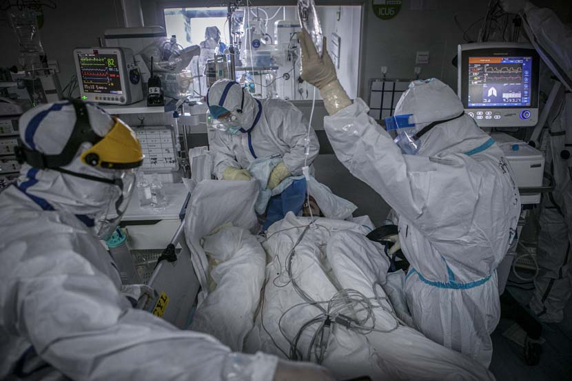 Medical workers sort equipment for a transferred patient in the Wuhan Pulmonary Hospital ICU, Hubei province, March 13, 2020. Sun Zhan for Sixth Tone