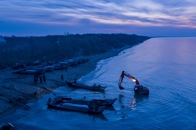 Fishers prepare for the new fishing season at Lake Khanka on the border between China and Russia in Baiyuwan Town, Heilongjiang province, April 25, 2020. Sun Changshan/IC