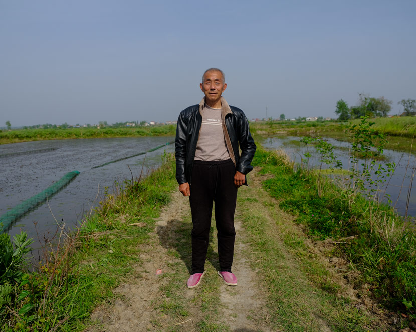 Zhang Taixin, a crawfish farmer, poses for a photo in Qianjiang, Hubei province, April 15, 2020. Shi Yangkun/Sixth Tone