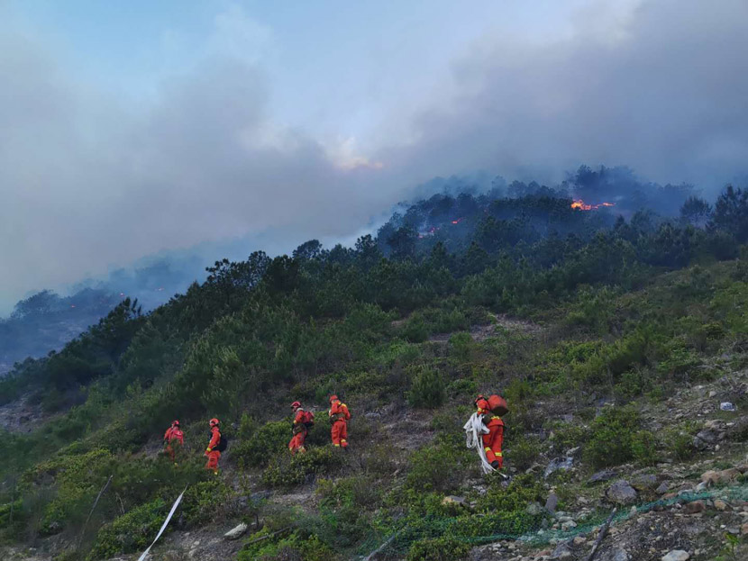Firefighters head toward a forest fire along the border of Xide and Mianning counties in Sichuan province, May 8, 2020. People Visual