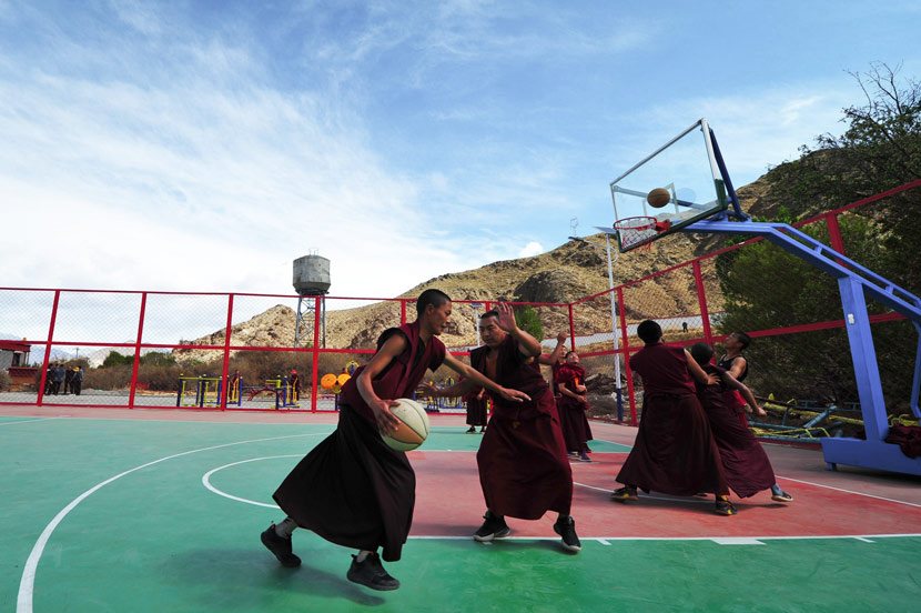 Monks play basketball at a monastery in Gonggar County, Tibet Autonomous Region, May 8, 2020. Zhang Wei/CNS/People Visual