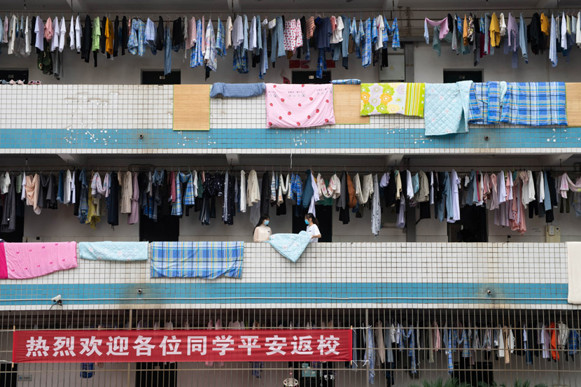 Students hang their laundry to dry outside their dorm rooms at a vocational college in Xiangtan, Hunan province, May 8, 2020. Chen Sihan via Xinhua