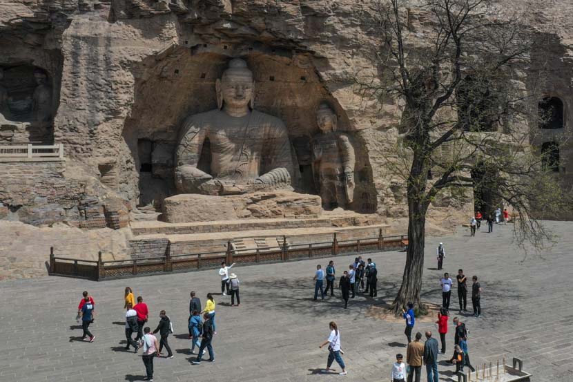 Tourists visit the Yungang Grottoes in Datong, Shanxi province, May 13, 2020. Wu Junjie/CNS/People Visual