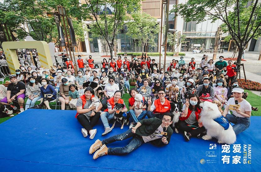 Wu Qi (front), the founder of Paw for Heal, poses for a group photo at the end of an animal-assisted therapy event at the Bund Finance Center in Shanghai, May 17, 2020. Courtesy of the Bund Finance Center