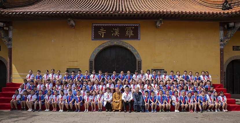 The abbot (in yellow) of the Buddhist temple poses for a group photo with the 108 children who were born there just after the 2008 Wenchuan earthquake, Shifang, Sichuan province, 2018. Courtesy of Wan Lei