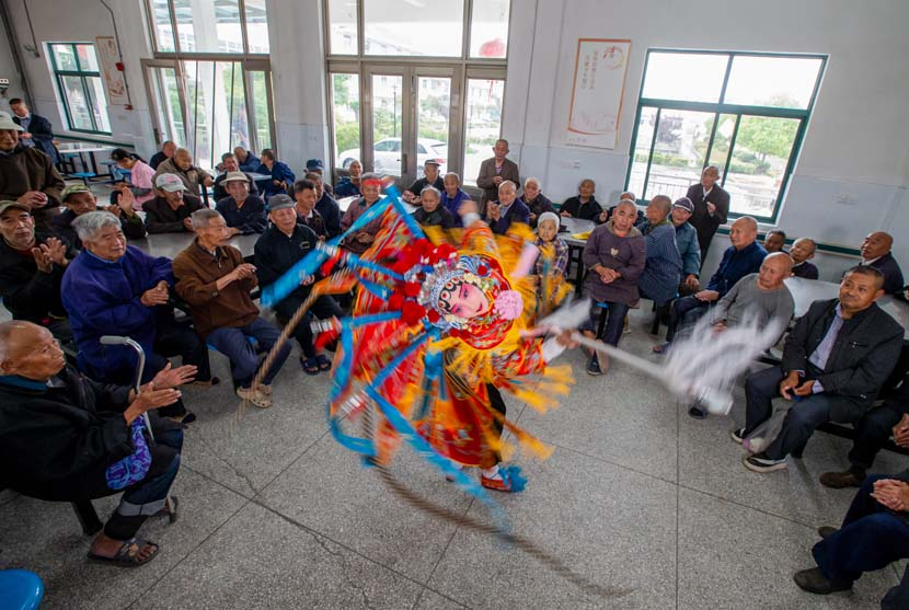 Students from a local primary school perform Beijing opera at a nursing home in Hai'an, Jiangsu province, May 30, 2020. People Visual