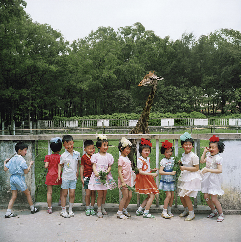 Children pose for a photo at a zoo in Guangzhou, Guangdong province, 1981-1982. Courtesy of Ryoji Akiyama via Seisodo