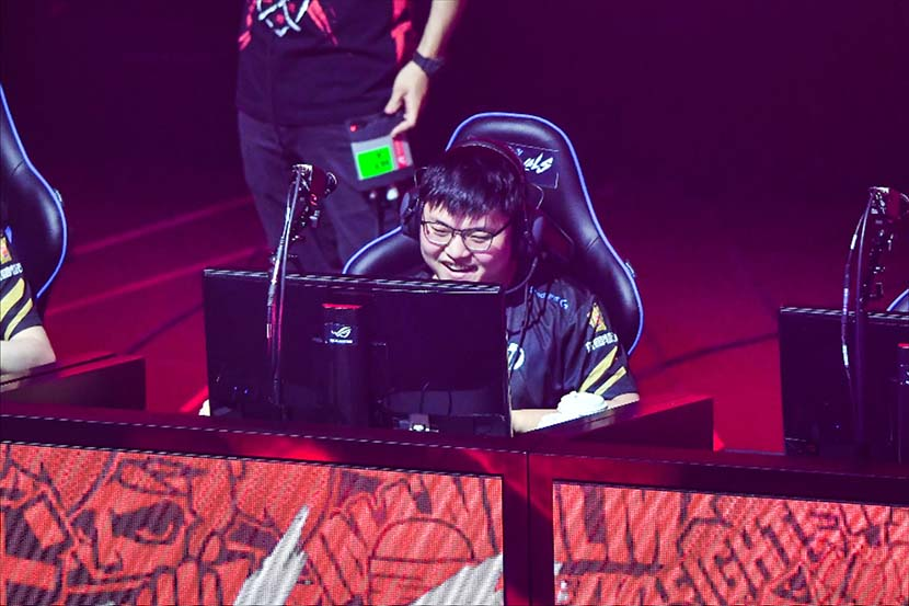 Chinese esports athlete Jian Zihao, better known as Uzi, smiles while playing in a League of Legends tournament in Dalian, Liaoning province, July 6, 2018. IC