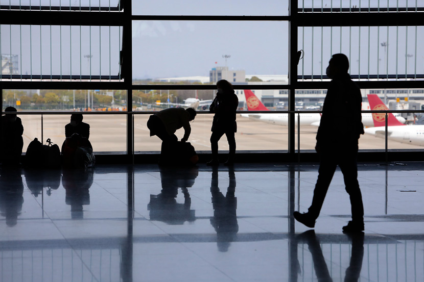 Passengers at Pudong International Airport in Shanghai, April 2, 2020. Yin Liqin/CNS/People Visual