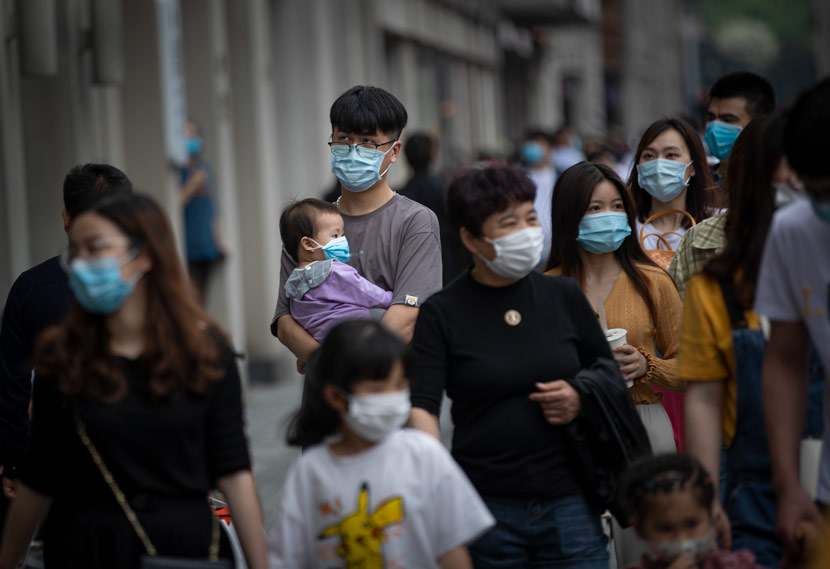 People wearing masks walk the streets in Wenzhou, Zhejiang province, May 1, 2020. People Visual