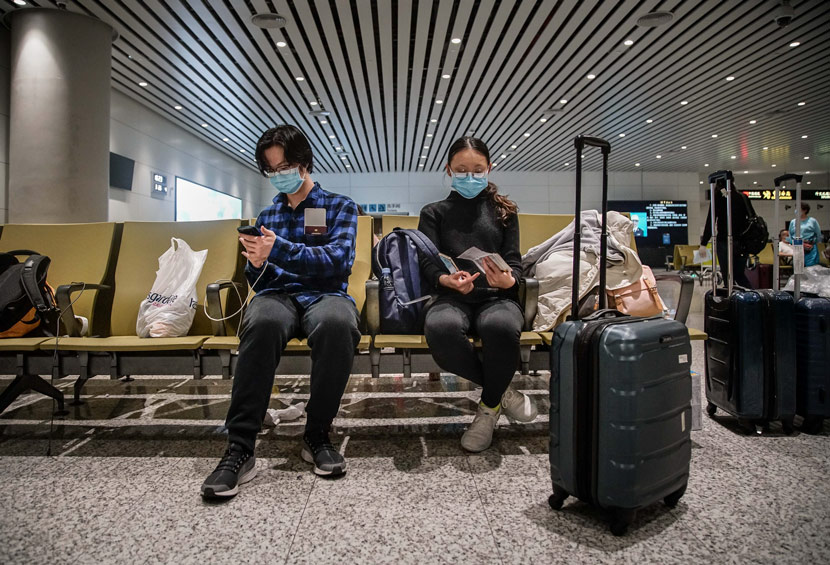 Overseas students returning from the U.S. arrive at an airport in Guangzhou, Guangdong province, March 26, 2020. Zheng Yijian/Southern Visual/People Visual