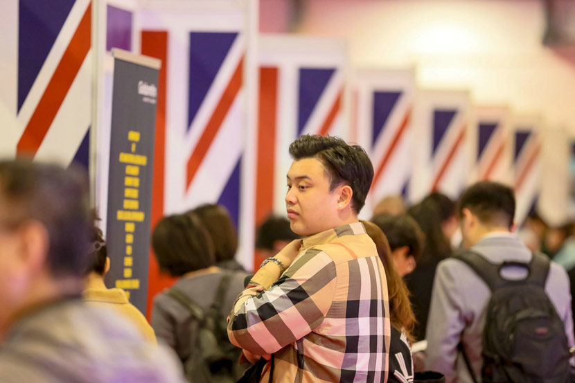 A man browses the booths at an educational fair in Beijing, Oct. 19, 2019. People Visual