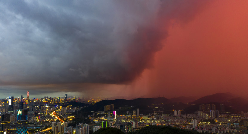 Dark clouds clash against the sunset in Shenzhen, Guangdong province, June 5, 2020. People Visual