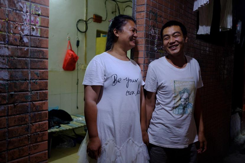 Zhang Yayun and her husband Tang Dongdong pose for a photo in front of their rental apartment in Longtan Village, Guangzhou, Guangdong province, April 30, 2020. Wu Huiyuan/Sixth Tone