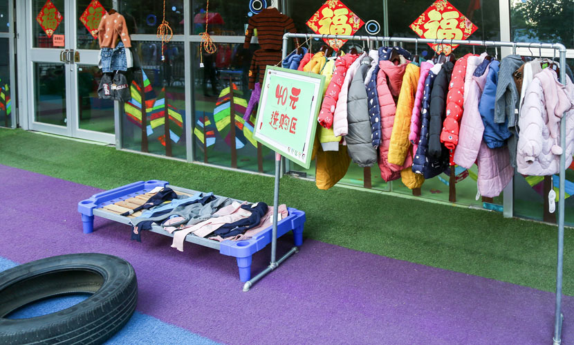 A principal sells kids clothing outside a private kindergarten, which has been closed for over four months, in Zhengzhou, Henan province, June 3, 2020. People Visual
