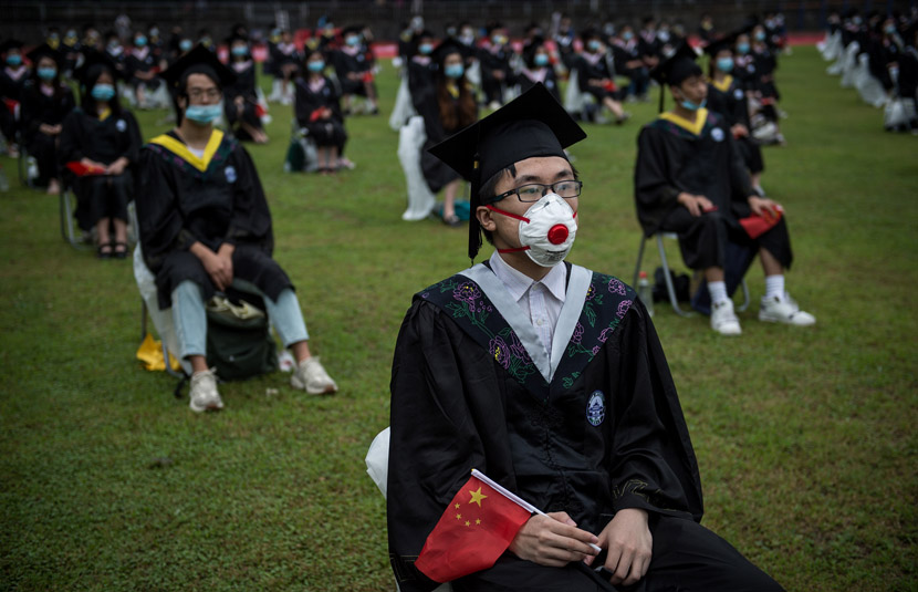 Students attend their graduation ceremony at Wuhan University, June 20, 2020. Don MCcurren/IC