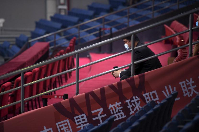 Yao Ming, chairman of the Chinese Basketball Association, watches a game in Qingdao, Shandong province, June 20, 2020. Li Ziheng/Xinhua