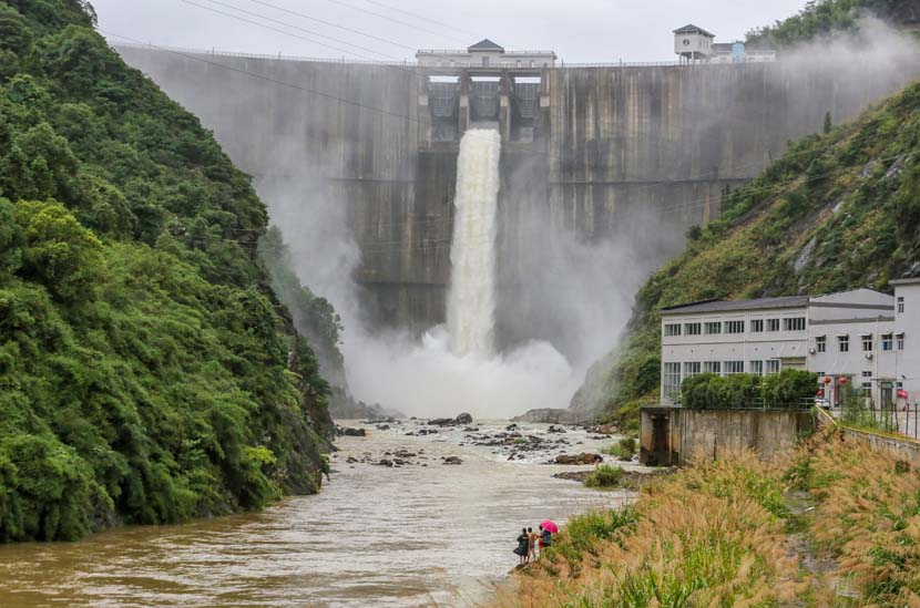 A reservoir discharges floodwater at Wugong Mountain in Pingxiang, Jiangxi province, June 26, 2020. People Visual