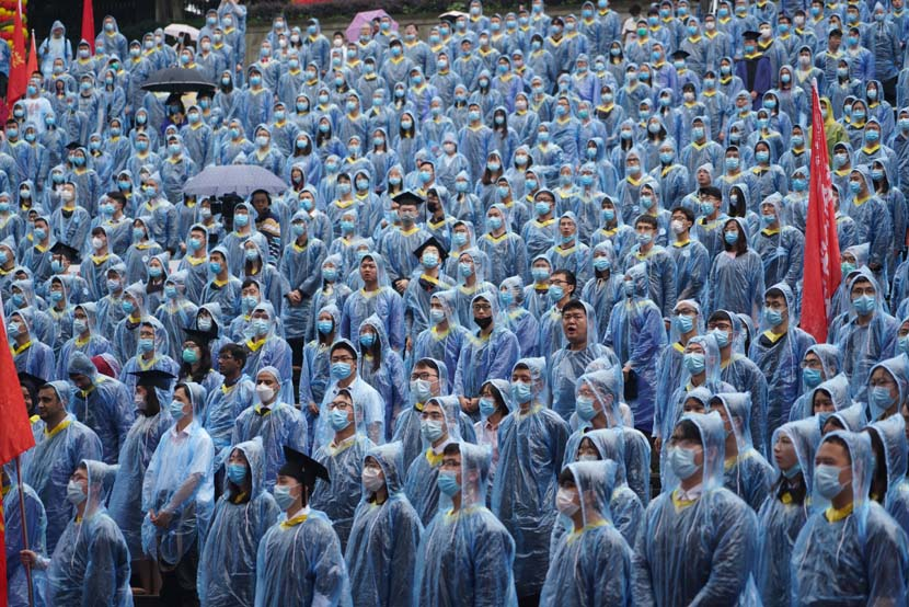 Students wearing rain ponchos attend an outdoor graduation ceremony at Chongqing University, Chongqing, June 28, 2020. People Visual