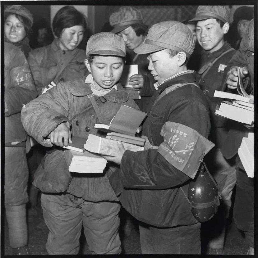 Teenagers buy Chairman Mao's works at a bookshop in Harbin, Heilongjiang province, Feb. 7, 1967. Li Zhensheng/The Chinese University of Hong Kong Press