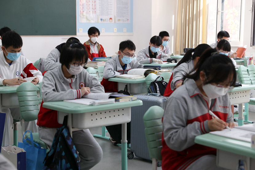 Students wearing masks study at a high school in Beijing, April 27, 2020. Jiang Qiming/CNS/People Visual