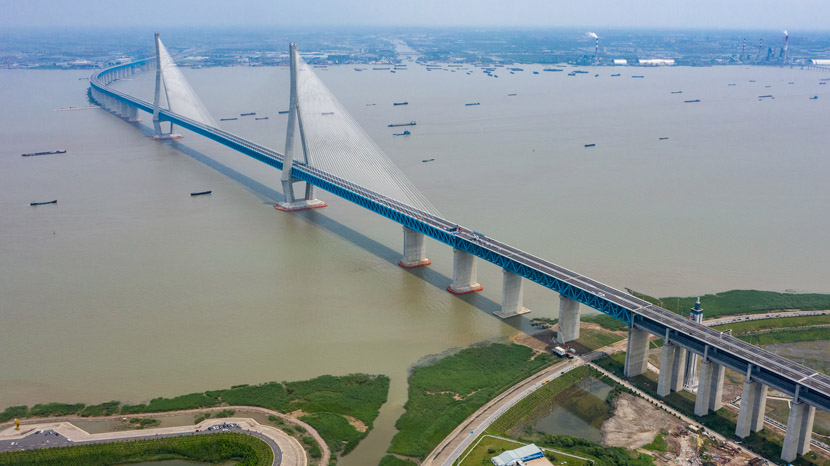 An aerial view of the Shanghai-Suzhou-Nantong Yangtze River Bridge, which opened for traffic this week, July 1, 2020. Construction on the 11 kilometer bridge took more than 6 years. Li Bo/Xinhua