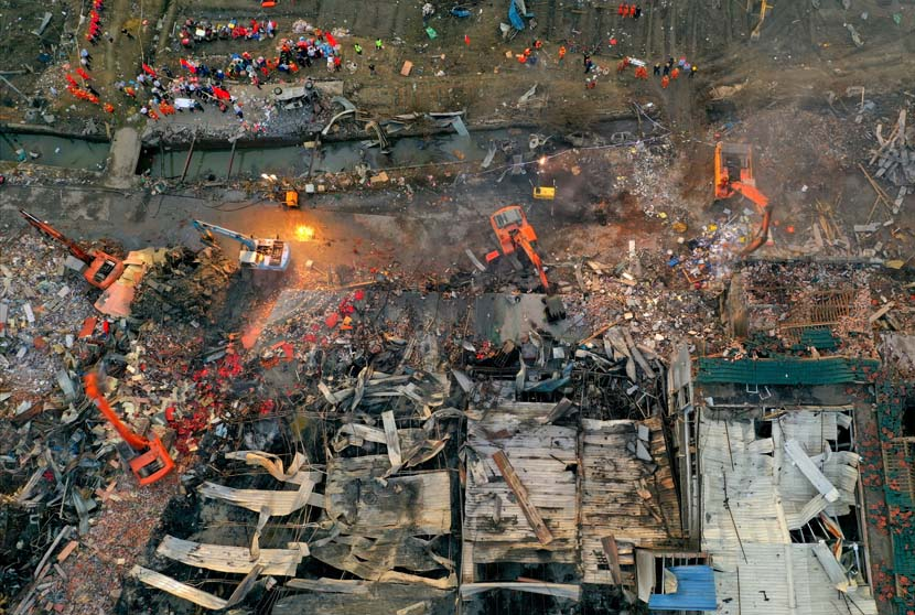 An aerial view of the site of an oil tank truck explosion on a highway in Wenling, Zhejiang province, June 14, 2020. The explosion left at least 19 people dead and injured up to 172, local authorities said. People Visual