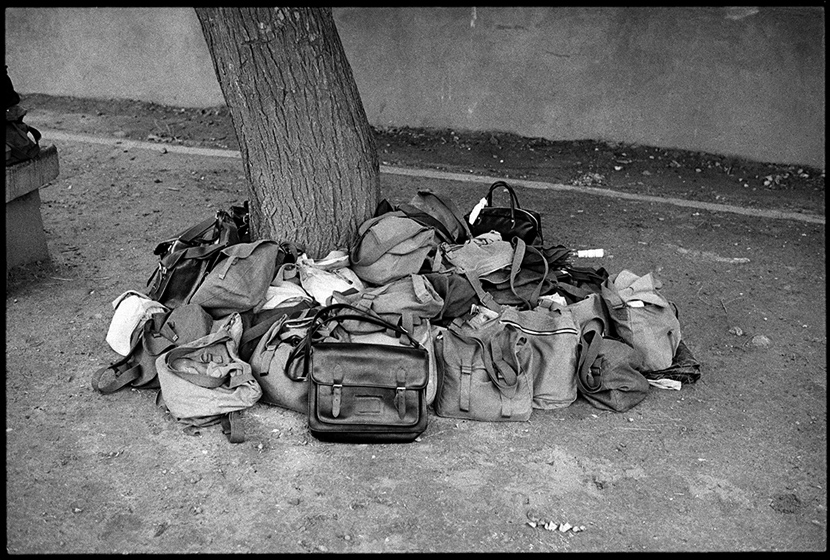 Candidates' belongings piled under a tree, Beijing, 1981. Ren Shulin for Sixth Tone