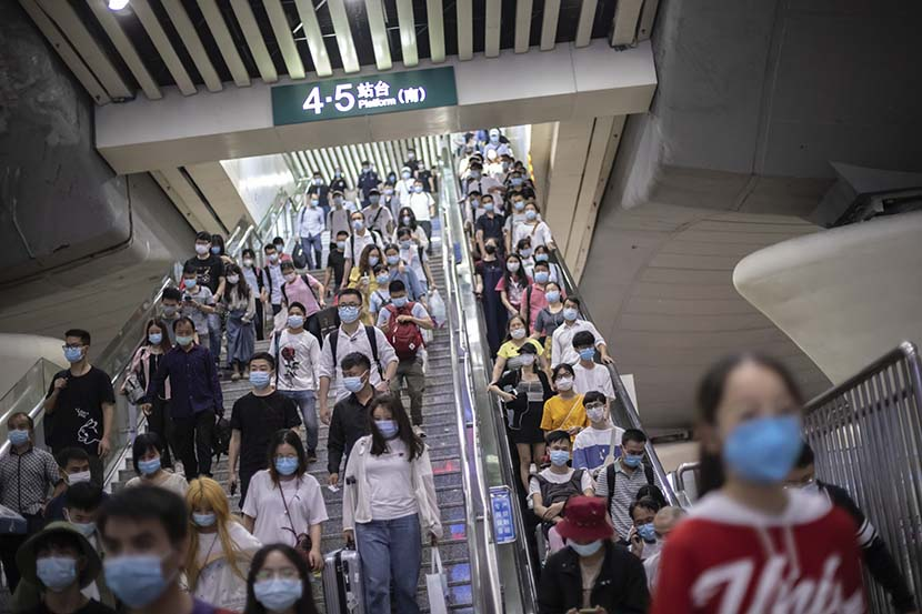 Passengers arrive at a subway station in Guangzhou, Guangdong province, May 4, 2020. People Visual