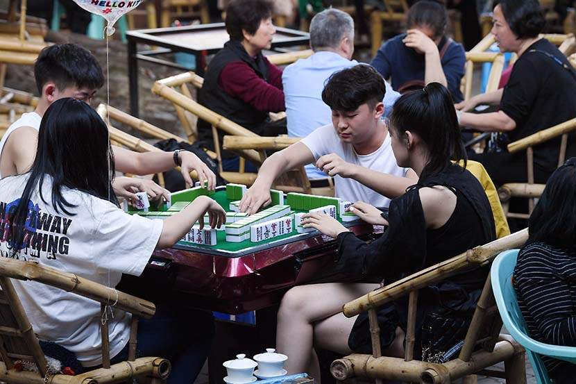 People play mahjong at a park in Chengdu, Sichuan province, April 7, 2020. People Visual