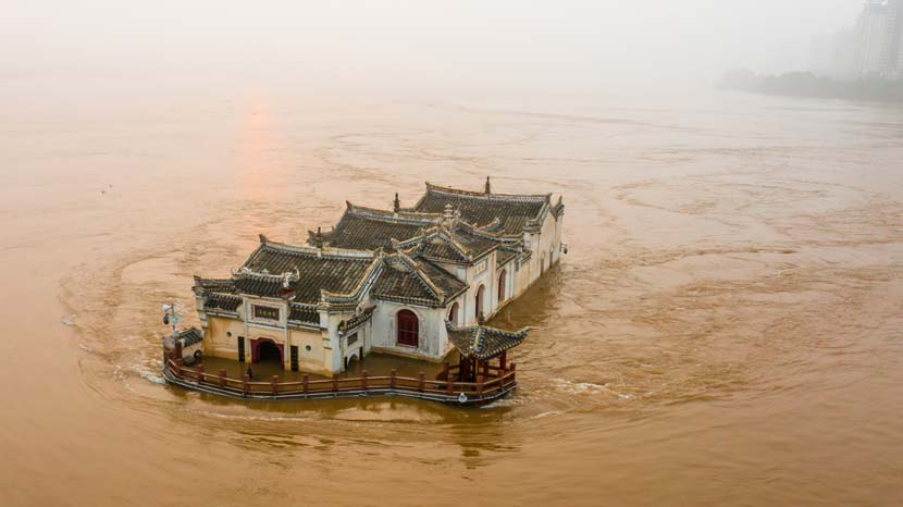 Floodwaters surround the 700-year-old Goddess of Mercy Pavilion in Ezhou, Hubei province, July 10, 2020. Zhang Hongbing/People Visual