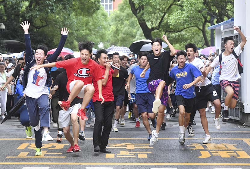 Students rush out of Changsha No. 1 Middle School after finishing the gaokao college-entrance exam, Changsha, Hunan province, July 8, 2020. Yang Huafeng/CNS/People Visual