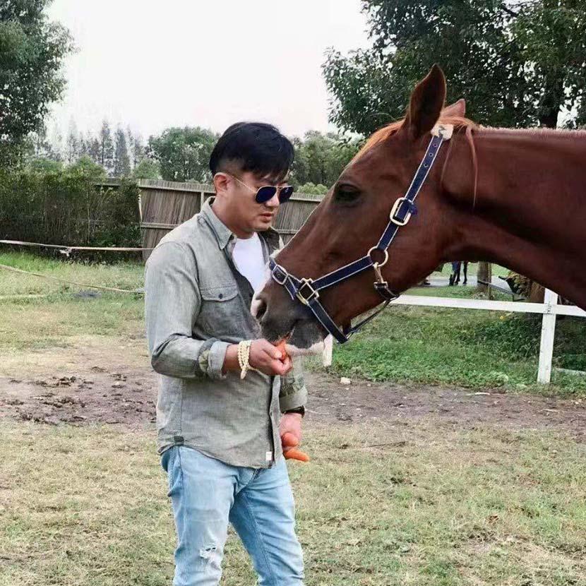 Wang Xinda and his horse Goddess. Courtesy of Wang