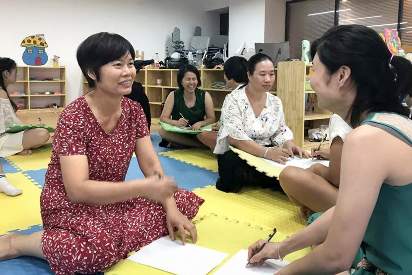 Domestic workers workshop lyrics to a song in Guangzhou, Guangdong province, 2019. Courtesy of Beijing Hongyan Social Work Service Center