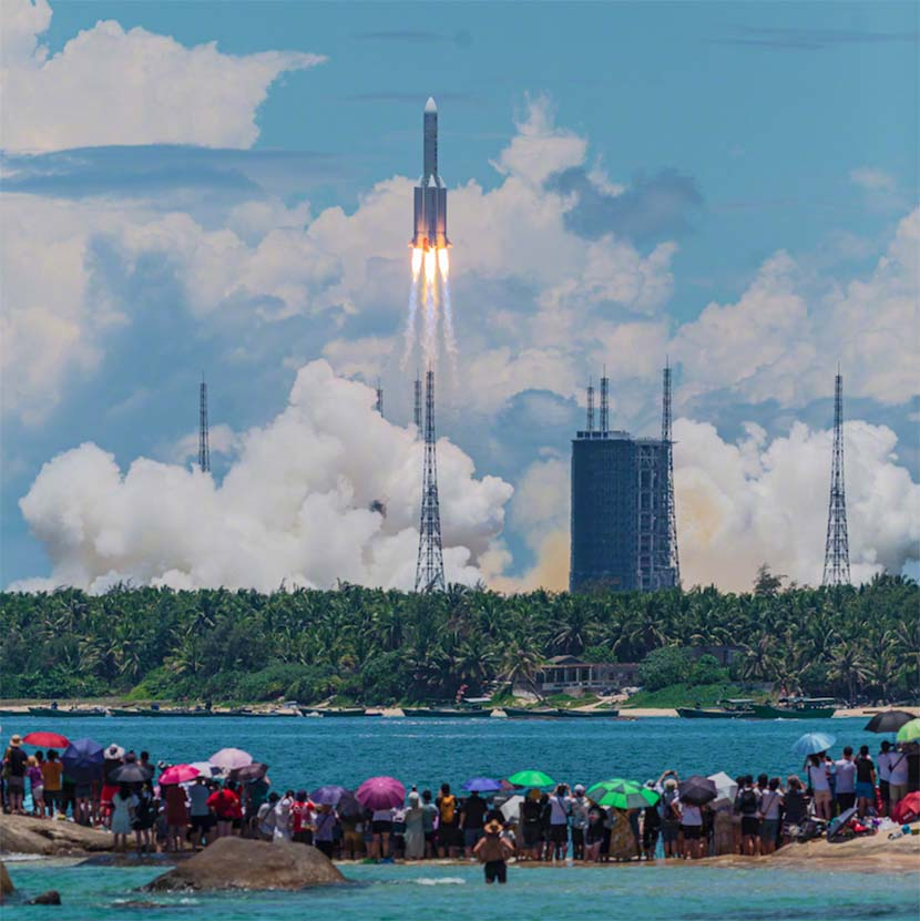 People watch the launch of China's Tianwen-1 Mars mission at the Wenchang Space Launch Center in Hainan province, July 23, 2020. Yu Jun for Sixth Tone