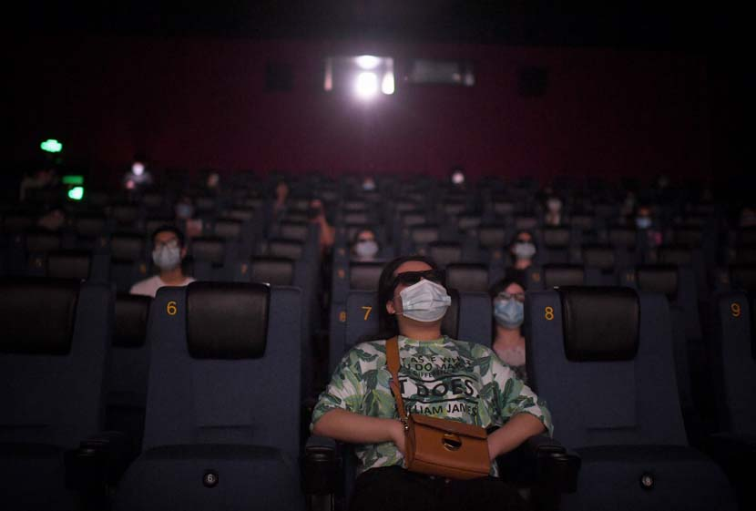 Audience members watch a film on the first day movie theaters were permitted to reopen nationwide since the coronavirus outbreak, Beijing, July 24, 2020. People Visual