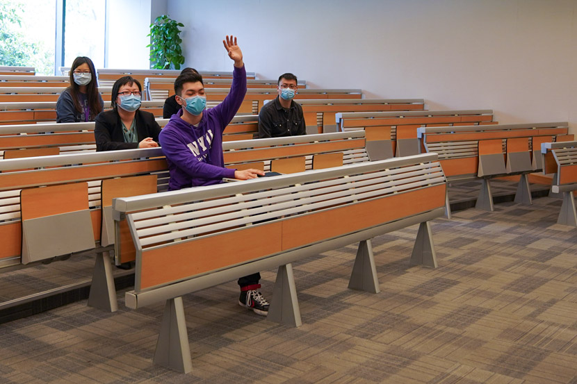 A student raises his hand during a class at NYU Shanghai, April 20, 2020. Courtesy of NYU Shanghai