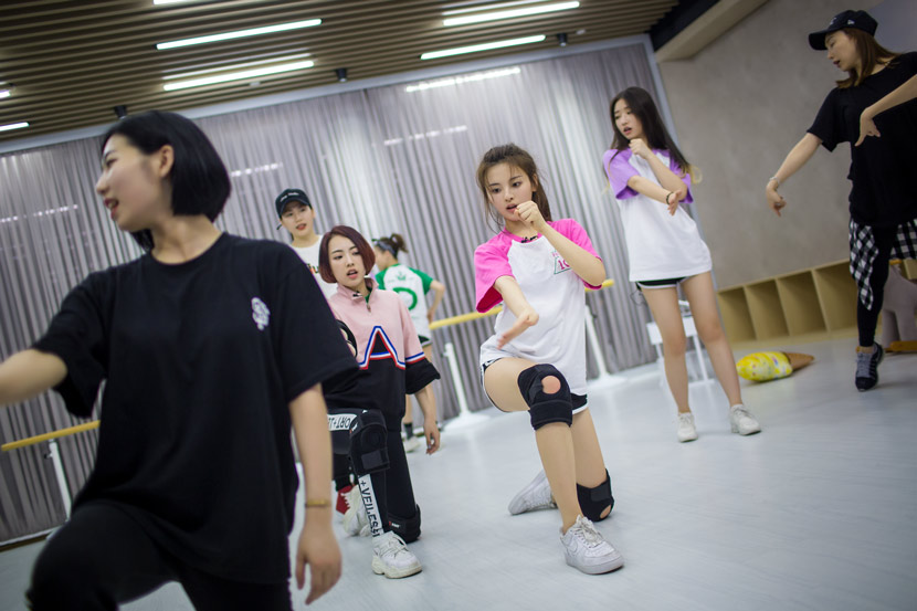 "Trainees practice a routine during on the set of ""Produce 101"" in Hangzhou, Zhejiang province, 2018. Chen Zhongqiu/People Visual"