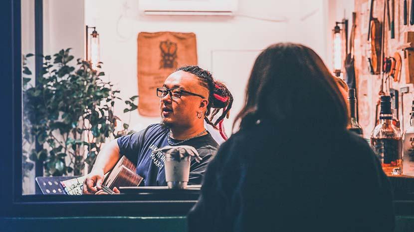 Tang Jiamin sings a song to a customer at the Story Store in Yuyuan Road, Shanghai, June 23, 2020. Courtesy of Tang Jiamin