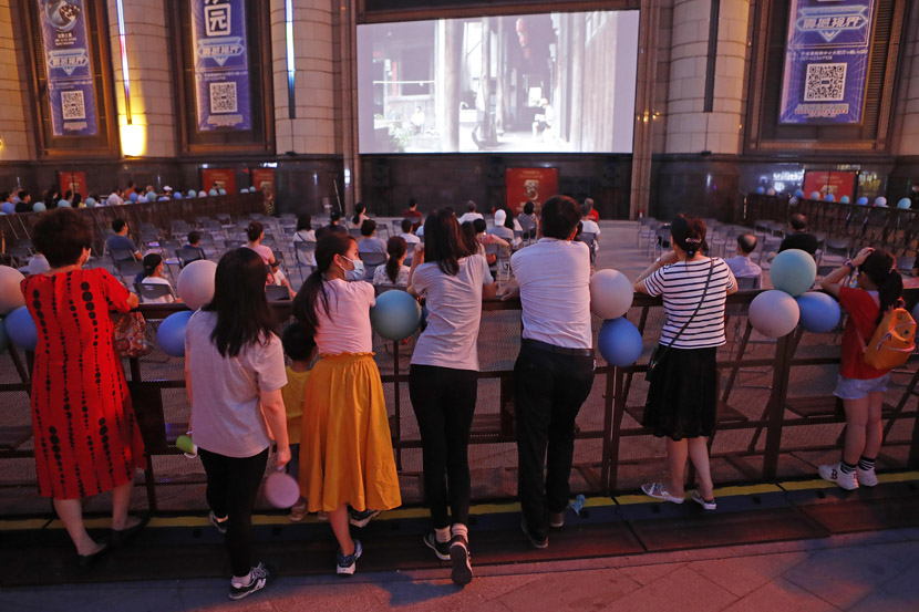People watch a movie outdoors during the Shanghai International Film Festival, July 27, 2020. Yin Liqin/CNS/People Visual
