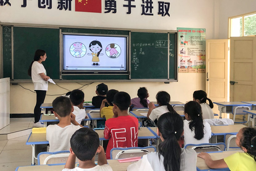 A teacher gives a sex education class at a rural primary school in Kang County, Longnan, Gansu province, July 29, 2019. Chen Bohan for Sixth Tone