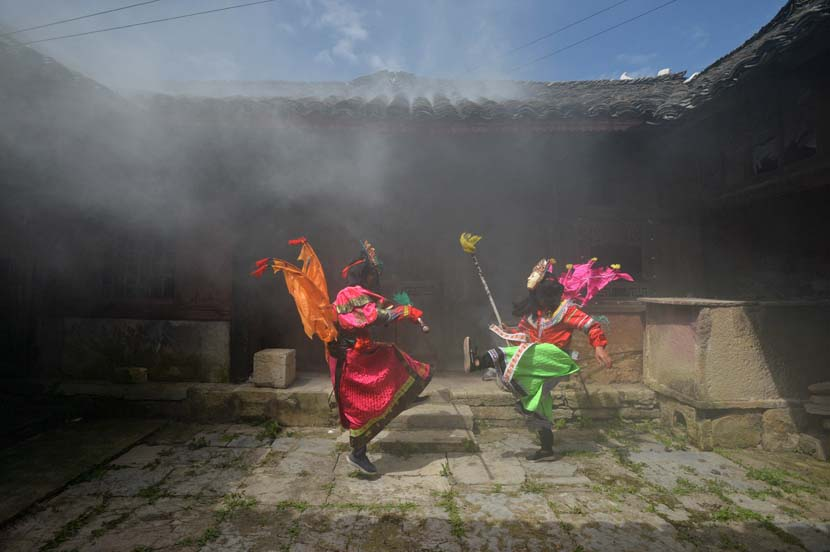 Actors perform a local opera at a village in Anshun, Guizhou province, Aug. 5, 2020. People Visual