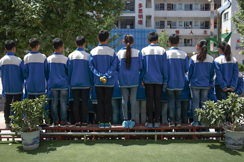 Students stand in rows for a group photo at No. 3 Middle School in Qishan County, Shaanxi province, May 17, 2017. Zhou Pinglang/Sixth Tone